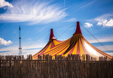 big top: Big top circus tent on a field in a park.