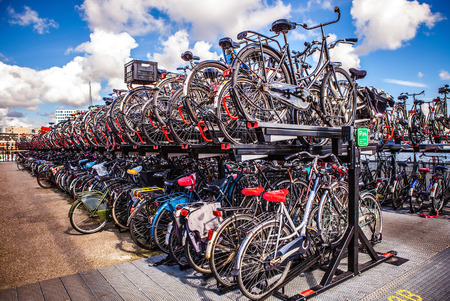 AMSTERDAM, NETHERLANDS - AUGUST 15, 2016: Two-level parking of bicycles in Amsterdam city. Amsterdam - Netherlands. Editorial