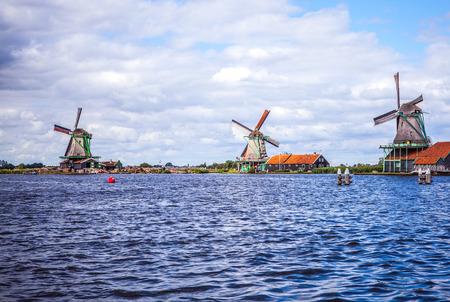 zaandam: Dutch windmills in Zaandam with dramatic cloudy sky.