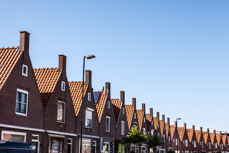 fasade: VOLENDAM, NETHERLANDS - JUNE 18, 2014: Traditional houses & streets in Holland town Volendam, Netherlands. Volendam - a small town that has preserved the tradition of Dutch fishing villages. Editorial