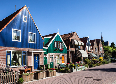 volendam: VOLENDAM, NETHERLANDS - JUNE 18, 2014: Traditional houses & streets in Holland town Volendam, Netherlands. Volendam - a small town that has preserved the tradition of Dutch fishing villages. Editorial