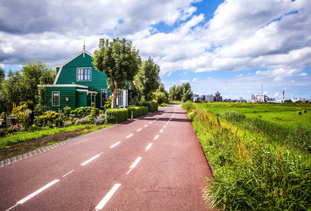 fasade: Traditional residential Dutch buildings. General landscape at twilight.