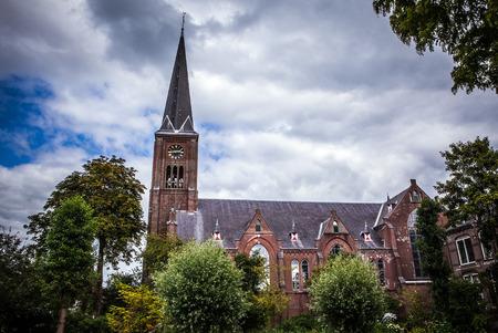 zaan: ZAANDAM, NETHERLANDS - JUNE 13, 2016: General landscape views in traditional church architecture of Zaan region at twilight on 13 June in Zaandam, Holland. Editorial