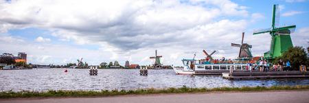 zaandam: Dutch windmills in Zaandam with dramatic cloudy sky. Panorama.