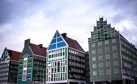 ZAANDAM, NETHERLANDS - JUNE 13, 2016: General landscape views in traditional architecture of Zaan region at twilight on 13 June in Zaandam, Holland.