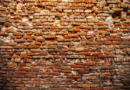 Ancient brick wall as background.