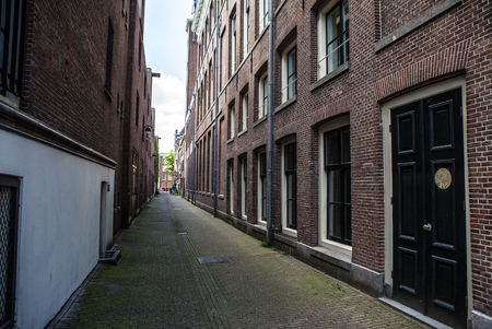 ancient pass: Narrow small empty streets of Amsterdam.