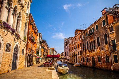 VENICE, ITALY - AUGUST 18, 2016: Famous architectural monuments and colorful facades of old medieval buildings close-up on August 18, 2016 in Venice, Italy.