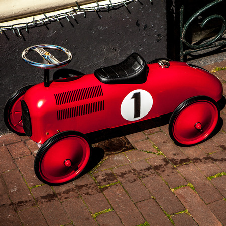 peddle: AMSTERDAM, NETHERLANDS - AUGUST 6, 2016: Classic Vintage Childs toy car close-up. Amsterdam - Netherlands.