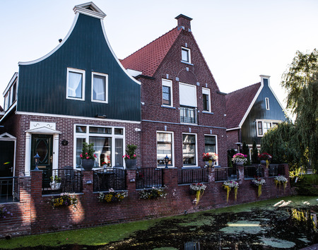 fasade: Traditional houses & streets in Holland town Volendam, Netherlands.