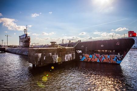 noord: AMSTERDAM - AUGUST 15: Old submarine on NDSM-werf - city-sponsored art community called Kinetisch Noord, center for underground culture in Amsterdam on August 15, 2010 in Amsterdam, Netherlands