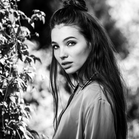 blackwhite: Black-white outdoors portrait of beautiful emotional positive young woman.