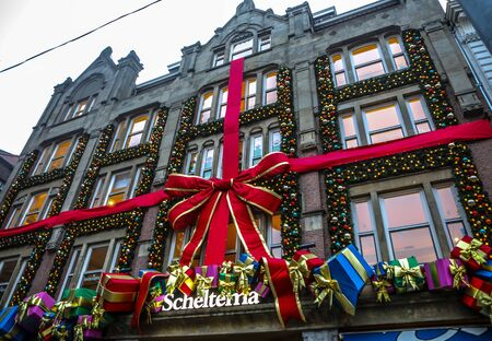 benelux: AMSTERDAM, NETHERLANDS - JANUARY 09, 2017: Famous vintage buildings of Amsterdam city. General landscape view at tradition Dutch architecture. January 09, 2017 - Amsterdam - Netherlands. Editorial