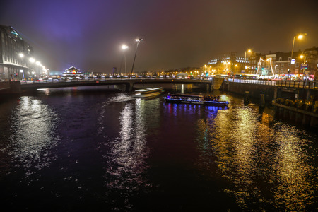 christmastime: AMSTERDAM, NETHERLANDS - JANUARY 02, 2017: Cruise boat in night canals of Amsterdam. January 02, 2017 in Amsterdam - Netherland. Editorial