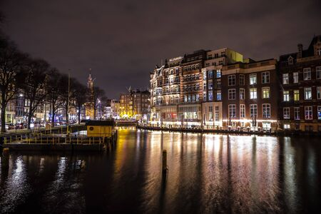 amstel river: AMSTERDAM, NETHERLANDS - JANUARY 08, 2017: City sights of Amsterdam centre at night. General views of city landscape and architecture. January 08, 2017 in Amsterdam - Netherlands.