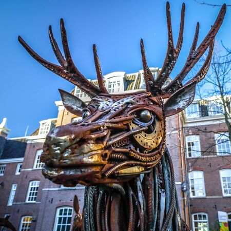 AMSTERDAM, NETHERLANDS - JANUARY 08, 2017: Dear from rusted metal elements. Famous sculptures of Amsterdam city centre. January 08, 2017 in Amsterdam - Netherlands. Editorial
