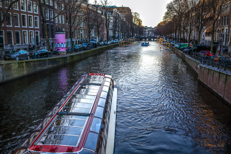 chanel: AMSTERDAM, NETHERLANDS - JANUARY 09, 2017: Boats on water in beautiful evening sun set. January 09, 2017 in Amsterdam - Netherland. Editorial