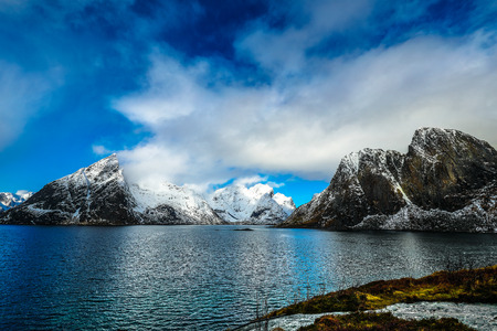 Magnificent snow-covered rocks on a sunny day. Beautiful Norway landscape. Lofoten islands. Stock Photo