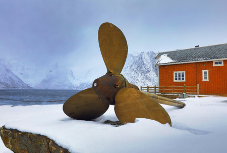 drydock: Ship propeller as a monument in the fishing village of Hamnoi, Lofoten Islands, Norway.