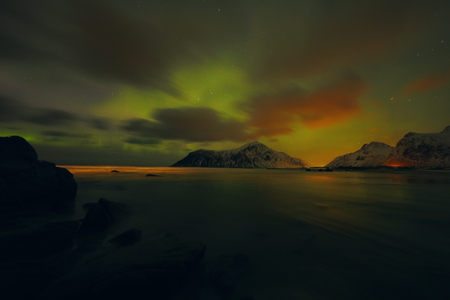 Amazing multicolored Aurora Borealis also know as Northern Lights in the night sky over Lofoten landscape, Norway, Scandinavia.