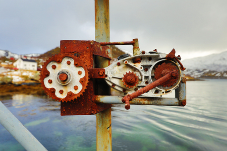 Old rusty ship winch against water close-up. Stock Photo