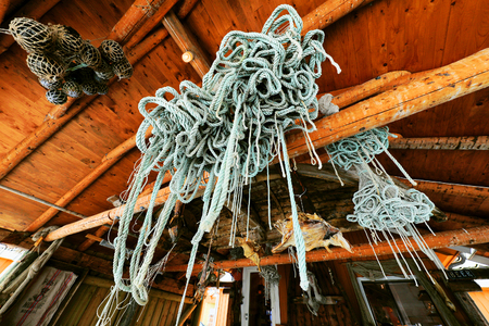 ploy: Ancient marine gear in a fishing settlement.