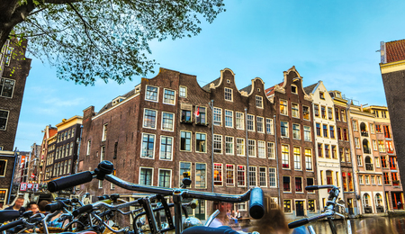 General view of traditional old famous houses in Amsterdam city.