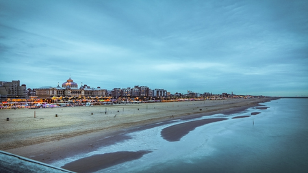 Scheveningen pier in The Hague general view of the coastline at twilight time.