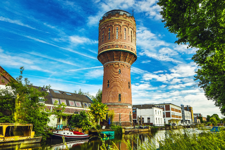 Old brick water tower in ancient European city of Utrecht, Netherlands