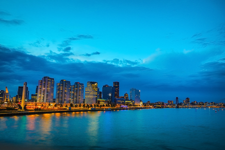 General view of Rotterdam city landscape at twilight time.