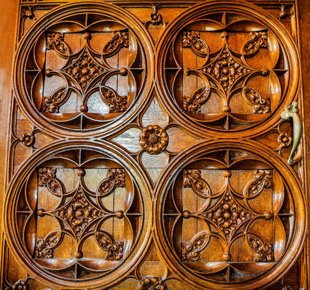 metal grid: Woodcarving texture of antic door close-up as background. Stock Photo