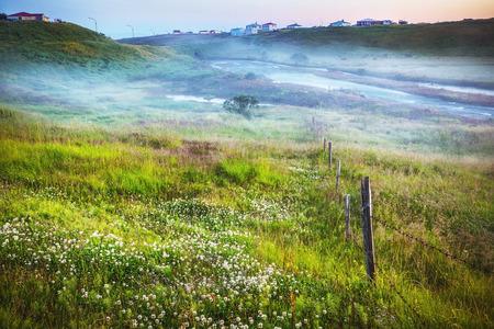 Scenic Icelandic morning landscape with mystical haze. Stock Photo