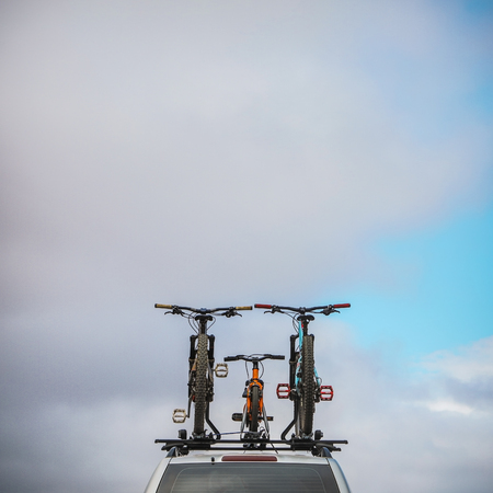Bicycles on roof of car.