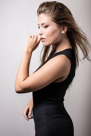 Young sensual model woman pose in studio.