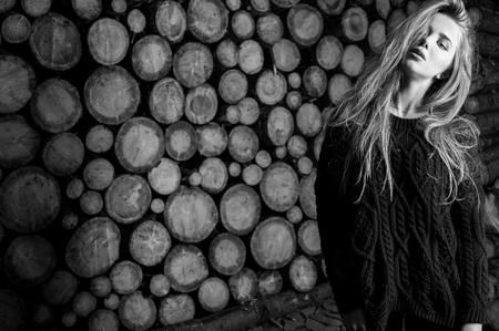 Attractive women portrait against wooden. Black-white.