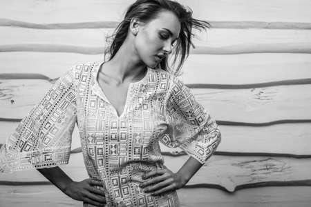 Attractive women against white wooden. Black-white. Banque d'images