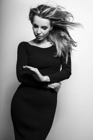 Young sensual model woman pose in studio. Black-white photo.