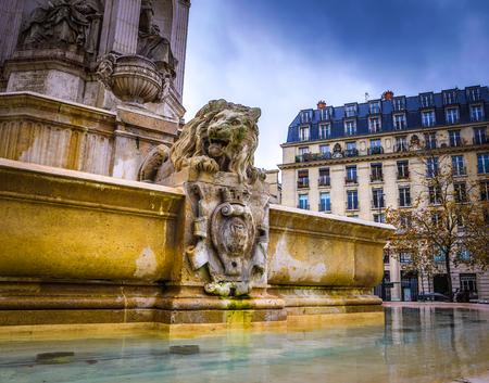 PARIS, FRANCE - NOVEMBER 11, 2017: Famous places and buildings of Paris at rainy autumn evening on Paris, France in November 11,  2017