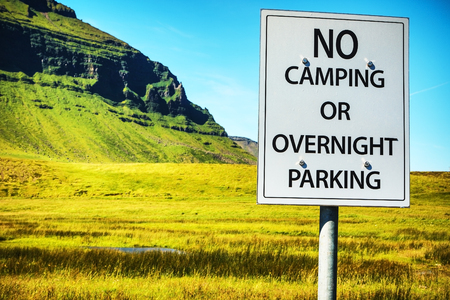 Sign - No camping or overnight parking. Stock Photo