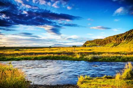 Picturesque landscape of a mountain river with traditional nature of Iceland.