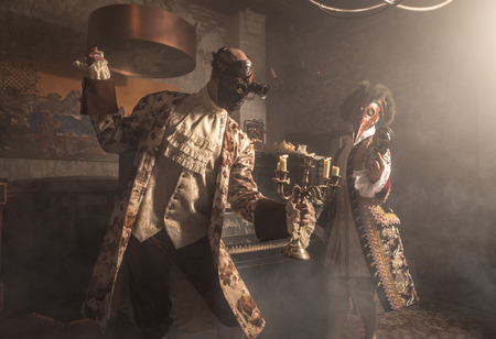 Actors in steam punk masks and antique costumes indoor.