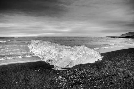 Glaciers on beaches of Iceland. Black-white photo. Reklamní fotografie
