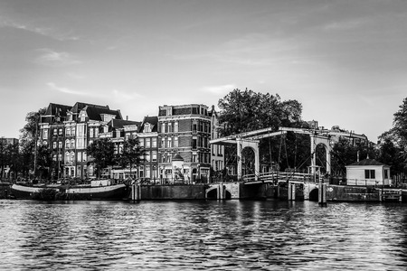 Ð¡anals and embankments of Amsterdam city. Black-white photo.