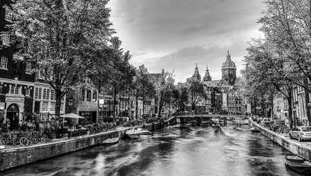 Ð¡anal and embankments of Amsterdam city. Black-white photo.