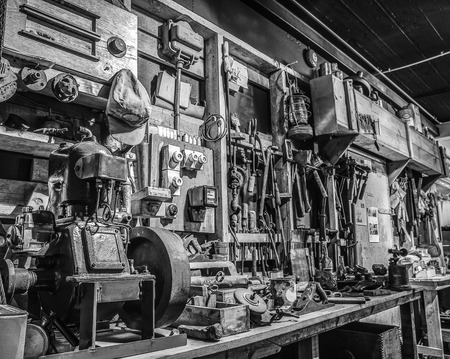 Workshop with old tools. Black-white photo.