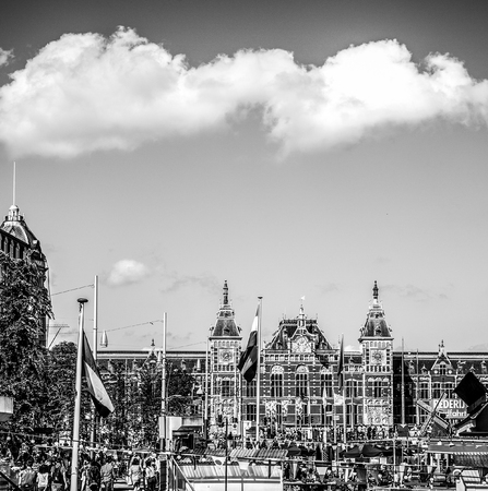 AMSTERDAM, NETHERLANDS - AUGUST 15, 2016: Famous buildings of Amsterdam city centre close-up. General landscape view of city streets and traditional Dutch architecture. Amsterdam - Netherlands. Editorial