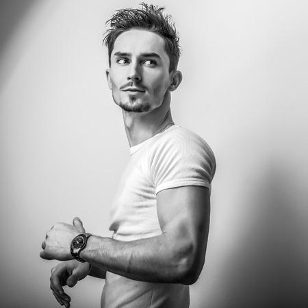 Elegant young handsome man. Black-white studio photo. Foto de archivo