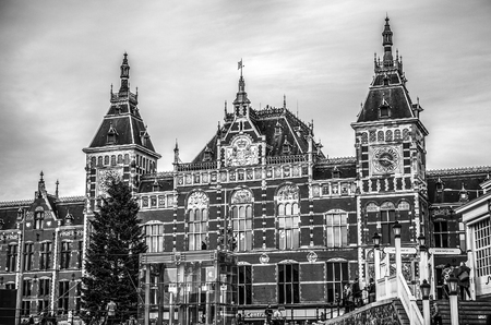 AMSTERDAM, NETHERLANDS - JANUARY 10, 2017: Famous vintage buildings of Amsterdam city black-white. General landscape view at tradition Dutch architecture. January 10, 2017 - Amsterdam - Netherlands.