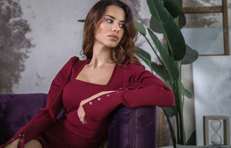 Beautiful young woman pose in modern interior.