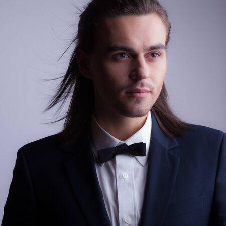 Handsome young elegant man studio portrait. Standard-Bild